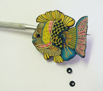 fish with needle tool