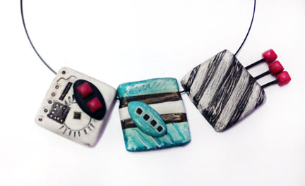 three polymer clay slides.